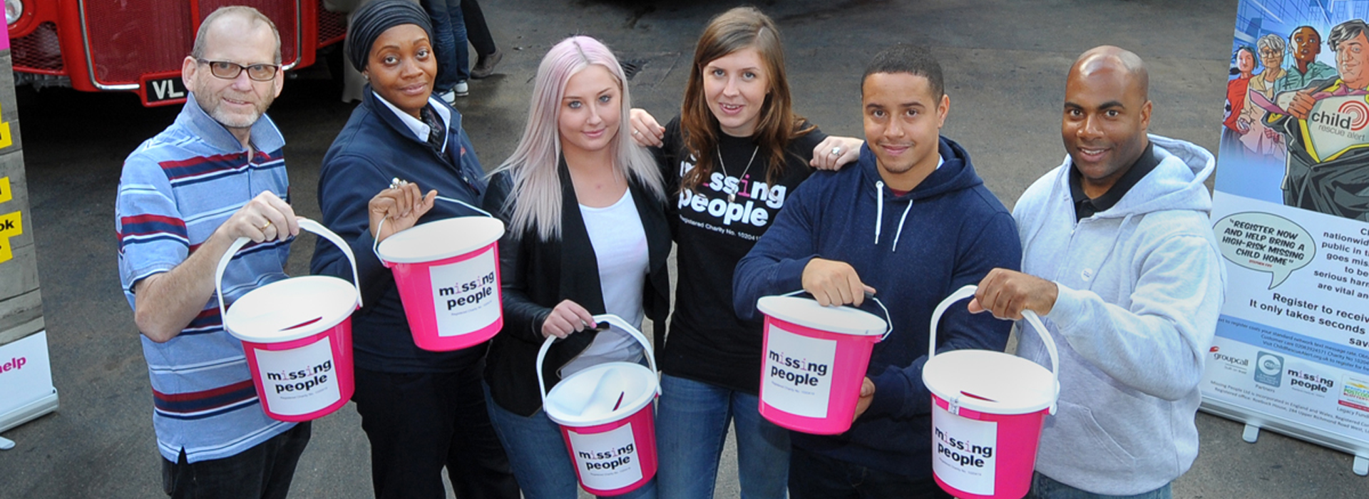 Missing People staff and supporters with fundraising buckets at a event