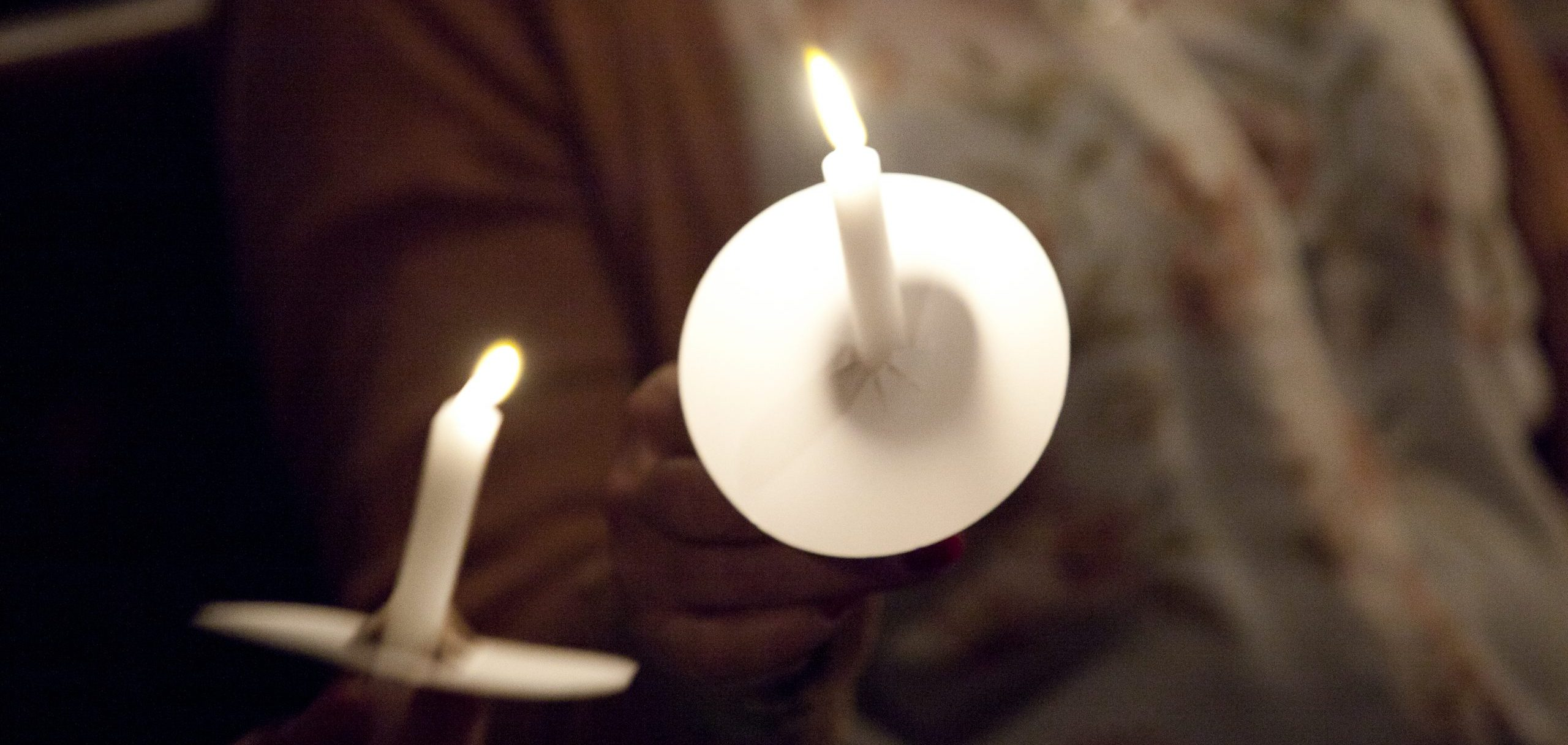 Lighting candles at the Carol Service
